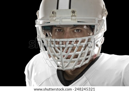 Close up in the eyes of a Football Player with a white uniform on a black background.