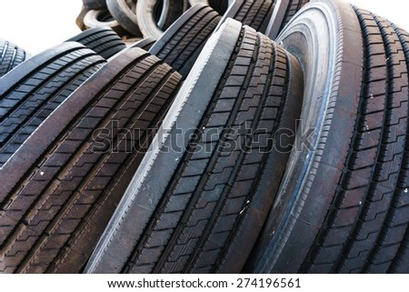 close up in tire heap with tires tread, used tires - stock photo