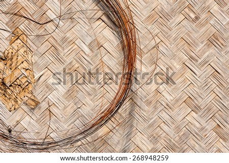 Close up iron wire old Woven flat mat made from bamboo grass background - stock photo
