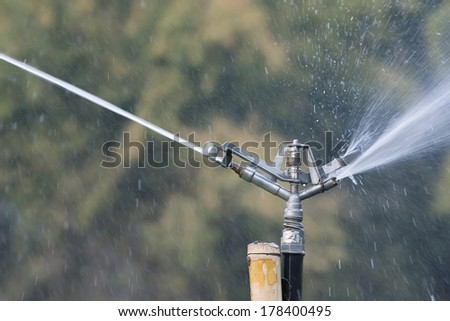 close up Irrigation system on green field  - stock photo