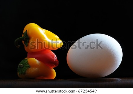 Close up isolated image of one egg and peppers