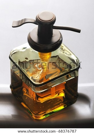 Close up isolated image of soap dispenser - stock photo