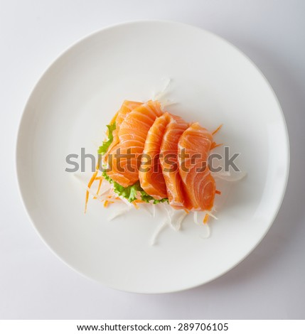 Close up japan style food sashimi from the salmon on the white plate - stock photo
