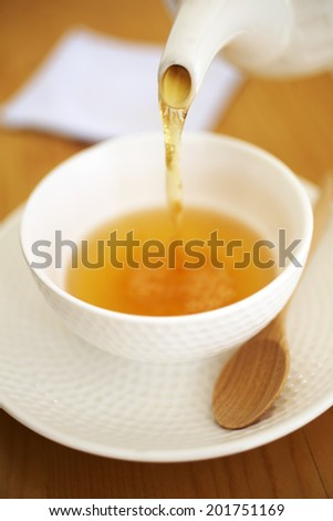 close up japanese hot tea in white cup