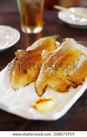 close up japanese smoked fish grilled in white dish