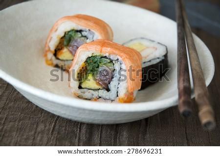 close up japanese sushi on white dish - stock photo
