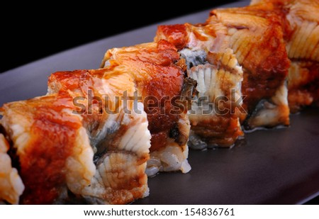 Close up Japanese sushi with eel on brown plate