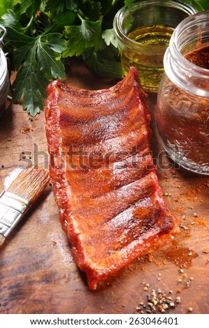 Close up Juicy Fried Pork Rib Meat on Wooden Table with Other Recipe Ingredients. - stock photo