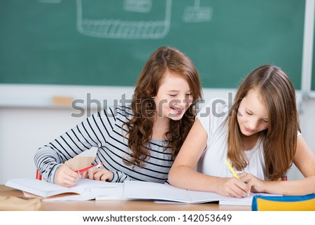 Close up kids in classroom studying their lesson in school - stock photo