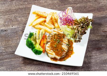 Close up king mackerel steak with pepper sauce - stock photo