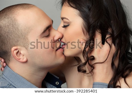 Close up kissing couple portrait