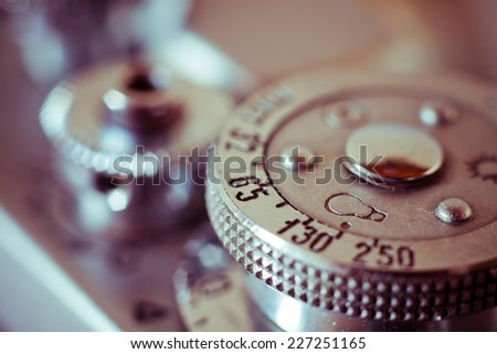 Close up lens detail of an old fashioned manual film camera switches, shallow depth of field - stock photo