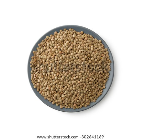 Close up Lentils heap on plate , isolated on white, clipping path - stock photo
