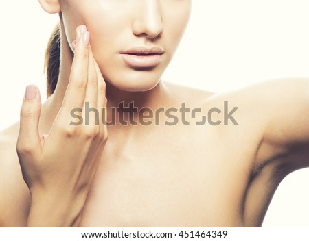Close-up lips and hand of young caucasian brunette woman with natural lips and make-up isolated on white.  - stock photo