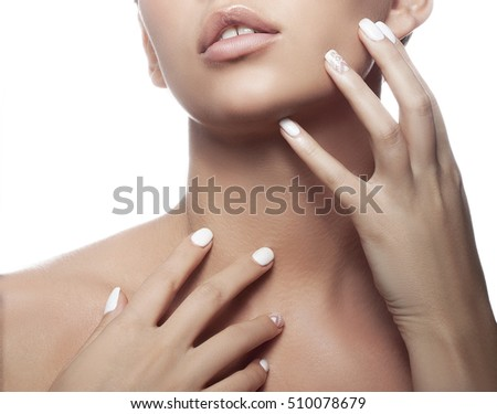 Close-up lips and shoulders of young caucasian girl with natural make-up, perfect skin and green eyes isolated on white background. Studio portrait.