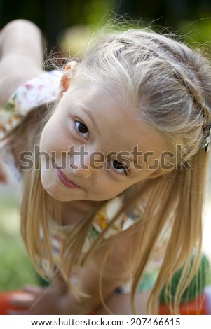 Close up, Little blonde girl in summer park - stock photo