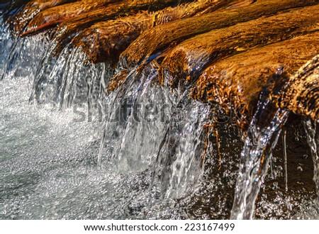 Close up little mountain waterfall - stock photo