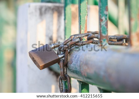 Close up lock and chain on steel fence - stock photo