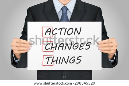 close-up look at businessman holding Action Changes Things poster - stock photo