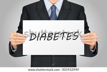 close-up look at businessman holding diabetes word poster - stock photo