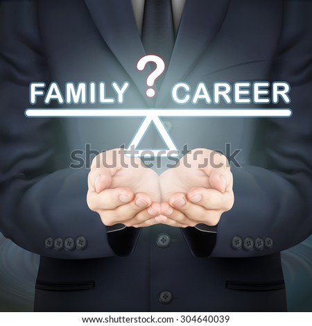 close-up look at businessman holding family and career seesaw - stock photo