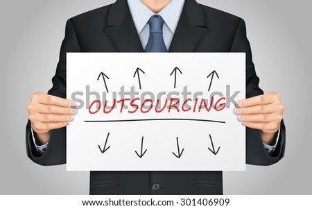 close-up look at businessman holding outsourcing poster - stock photo