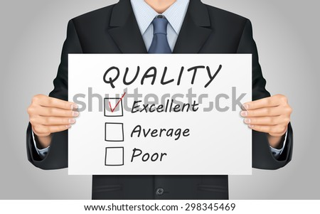 close-up look at businessman holding quality survey poster - stock photo