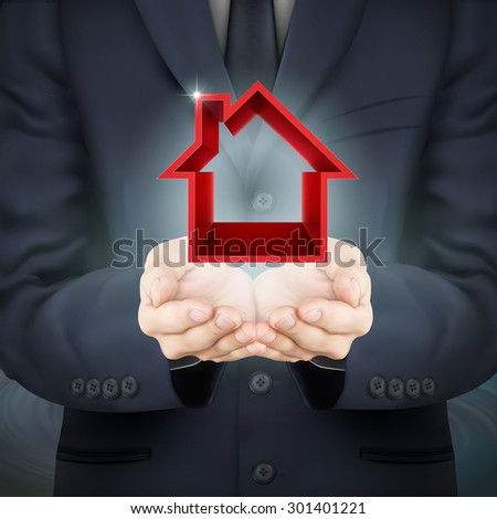 close-up look at businessman holding real estate icon - stock photo