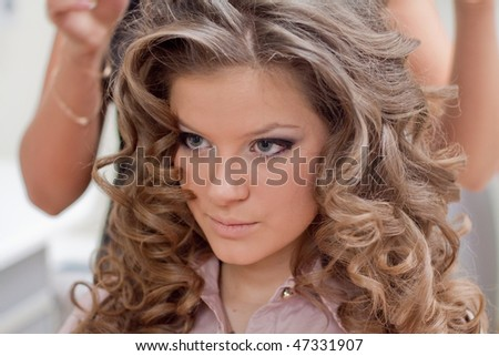 close up look of pretty curly-haired woman