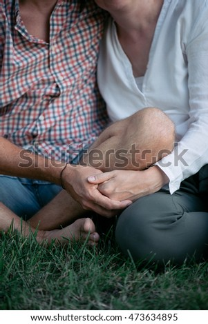 close up loving couple holding hands outdoor