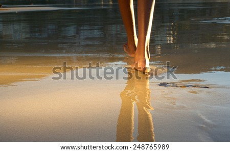 Close up low angle african american woman walking on beach