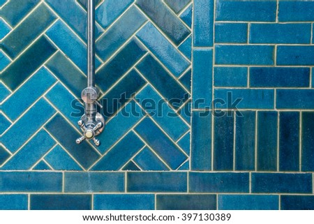Close up Luxury outdoor rain showers with blue tile