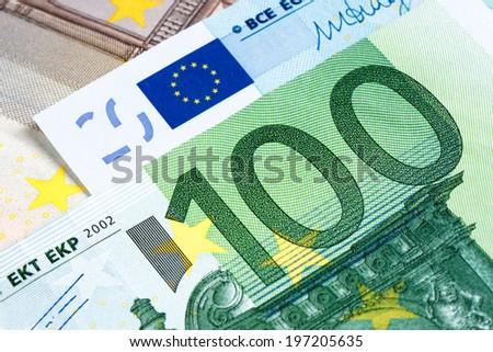 Close up macro detail of euro money banknotes - stock photo