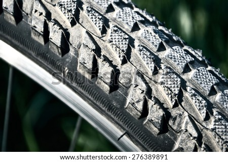 Close up macro image of bicycle tire. Sport conceptual image. - stock photo