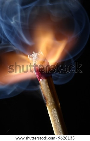 Close up macro of a burning match - just ignited