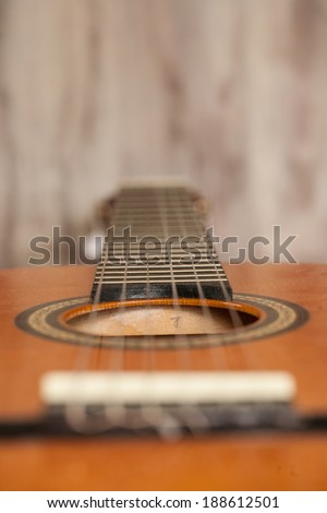 Close up macro of acoustic guitar laying on its back - stock photo
