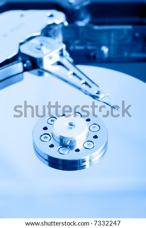 close up macro of an opened computer harddrive - stock photo