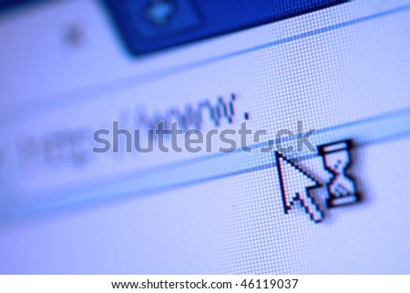 Close-up macro of browser address bar with mouse and hourglass - stock photo
