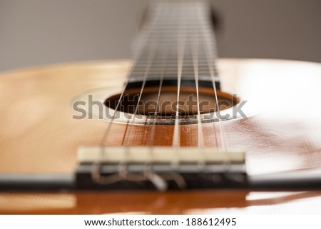 Close up macro of wood acoustic guitar for playing music - stock photo