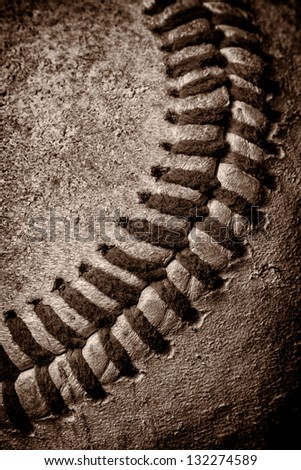 Close up macro view of red stitched seams of an old baseball - stock photo