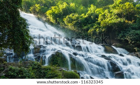 close up maeya water fall of chiang mai thailand with sun light - stock photo