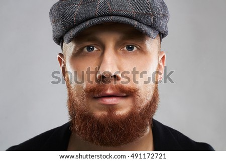 close-up male face with mustache and beard.fashion Portrait of young bearded man in hat