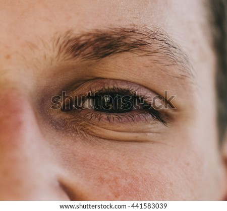 Close-up man face with eye in susnet time - stock photo