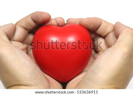Close up man hand holding red sponge heart, love symbol on white background .
