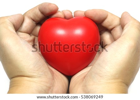 Close up man hand holding red sponge heart, love symbol on white background