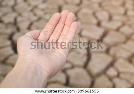 Close up, Man hand with Dry soil in arid areas - stock photo