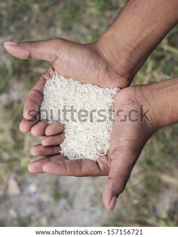 close up man hand with rice in love shape - stock photo
