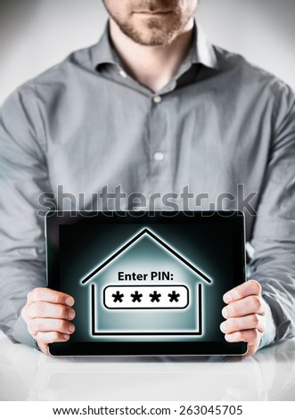 Close up Man in Long Sleeves Shirt Holding Tablet Gadget Showing Conceptual Enter Pin Inside a Home Display on the Screen. - stock photo