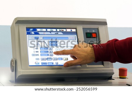 Close up Man Operating Touch Screen Device at the Table Inside the Office. - stock photo