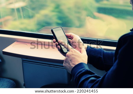close up man's hands using cellphone - stock photo